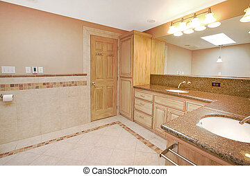Stone tiles in master bathroom