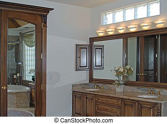bathroom vanity with view of tub through  mirror