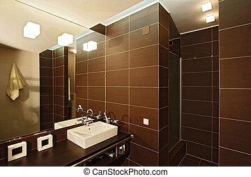 Bathroom with a mirror, a bowl and a per capita cabin