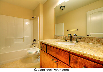 Bathroom with a tub and nice cabinets. Nice home in...