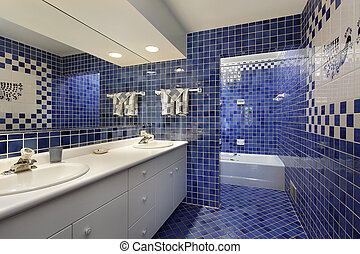 Bathroom with blue tile - Bathroom in upscale home with blue...