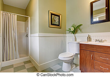 Bathroom with checkered tile floor, and green white walls.