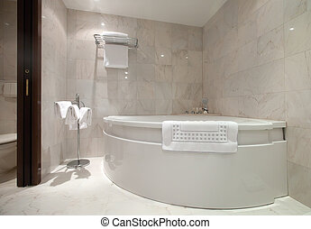 bathroom with corner bathtub - Interior of bathroom with...