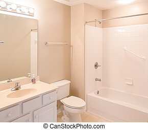 A modern new bathroom with handicapped grab bars in the tub
