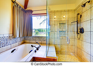 Bathroom with natural tiles and glass shower