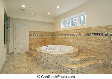 Bathroom in luxury home with round tub