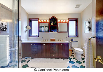 Bathroom with shower, dark wood cabinet, square tiles.