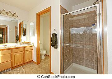 Bathroom with shower door