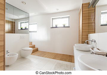 Bathroom with toilet and wide mirrors - Light bathroom with...