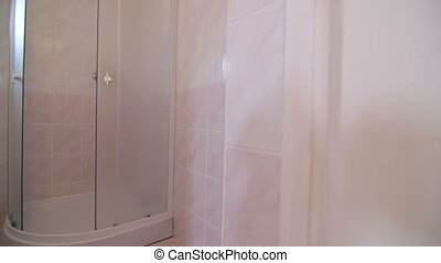 Bathroom with toilet sink and shower in cheap budget hotel room