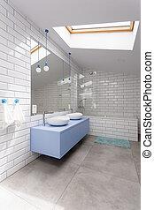 Bathroom with white brick wall