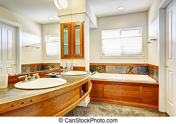 Bathroom with wood and tile trim.