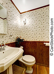 Bathroom with wood and wallpaper trim