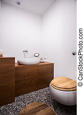 Bathroom with wooden decorations