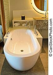Bathtub in a luxurious hotel room.