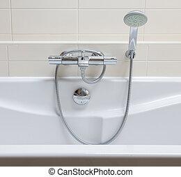 Bathtub in a tiled bathroom
