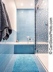 Bathtub in blue bathroom