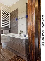 Bathtub in brown bathroom