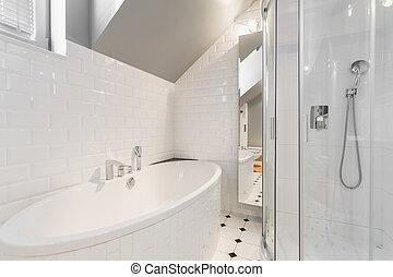 Bathtub in white bathroom