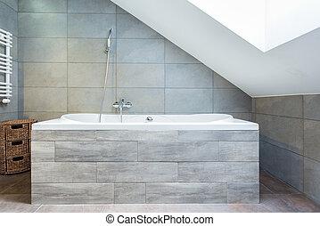 Bathtub with wooden housing