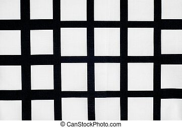 Batiste fabric texture. Checkered black and white dice