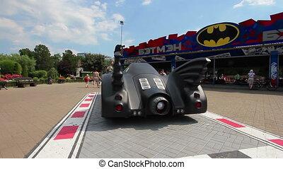 Thematic decoration - batmobile, amusement park, sunny day