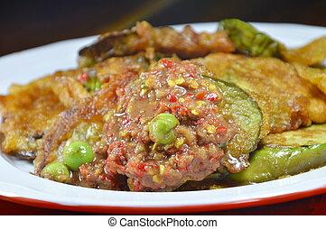 batter fried eggplant with egg dressing spicy shrimp paste sauce on dish