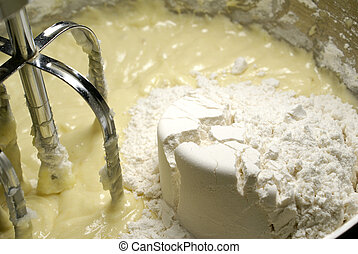 Batter - mixing a cup of flour into the batter with the...