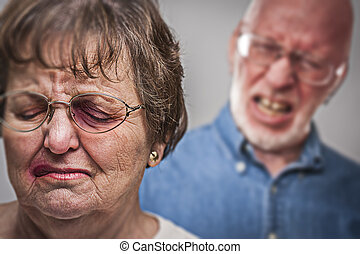 Battered and Scared Woman with Ominous Man Behind - Battered...