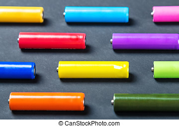 batteries of different colors in a box