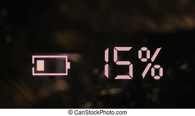 Battery charging icon displayed on an electronic gadget, smudgy screen