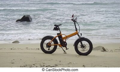 Battery Powered Bicycle Parked on Sandy, Tropical Beach -...