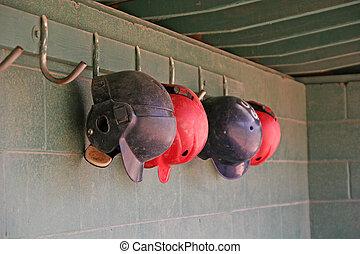 Batting Helmets - Old blue and red batting helmets hanging...