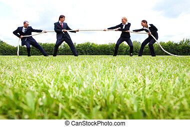 Battle - Photo of business people stretching the rope in the...