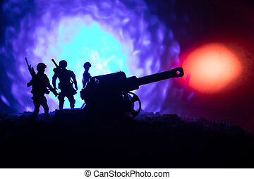 Battle scene with arillery and standing soldiers. Silhouette of old field gun standing at field ready to fire. With colorful dark foggy background.