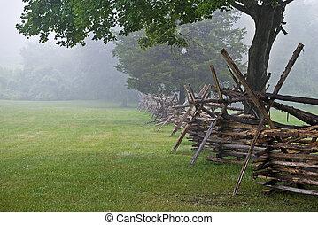 Battlefield Fence - A Wooden fence along the open field in...