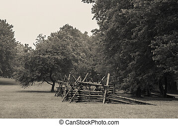 Battlefield Fence - An age toned black and white photograph...