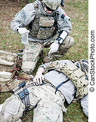 Battlefield medicine - United States Army ranger treating...