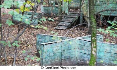 battlefield of paintball game with small houses,...