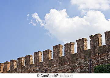 Fortifications on top of a stone wall