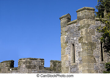 norman battlements and tower against a blue sky in the UK