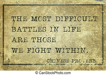 the most difficult battles - ancient Chinese proverb printed on grunge vintage cardboard