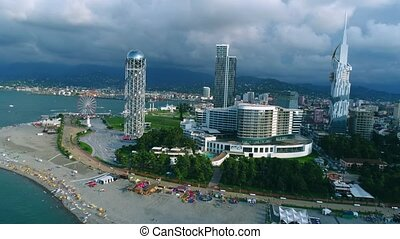 Batumi cityscape at cloudy day, aerial drone view