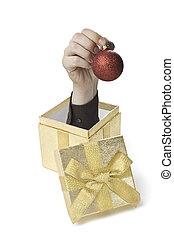 Baublebox - Eine Hand komt aus einer Geschenkebox heraus