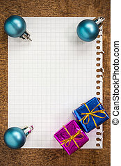 Baubles and gifts with empty paper sheet