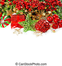 baubles, golden garlands, christmas tree and red berries