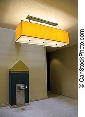 """Eighties """"deco techno"""" style interior, water fountain and hanging light"""