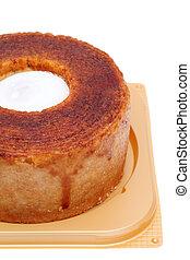 baum kuchen - baumkuchen with white whipped cream on tray