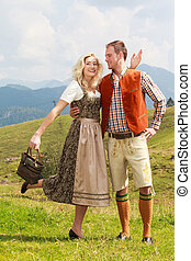Bavarian couple in fashionable leat