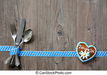 Bavarian cutlery on wooden table with copy space